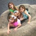 How many little girls fit into a dinosaur footprint?